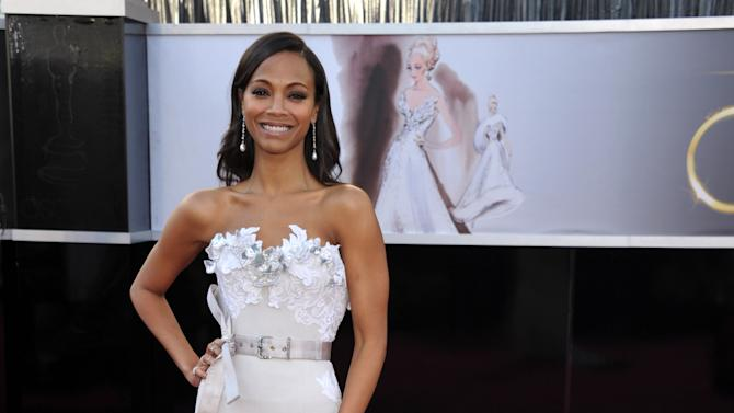 Actress Zoe Saldana arrives at the 85th Academy Awards at the Dolby Theatre on Sunday Feb. 24, 2013, in Los Angeles. (Photo by John Shearer/Invision/AP)
