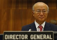 "UN atomic energy chief Yukiya Amano chairs a meeting of the International Atomic Energy Agency in Vienna. Amano has hit out at Iran's refusal to address allegations of nuclear weapons research and called on Tehran to allow access to a suspect military site ""without further delay"""