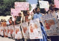 Indian activists hold placards during a 2002 rally against female foeticide in Lucknow. Twelve Indian doctors have been suspended for allegedly conducting prenatal sex tests, a practice banned to stop the abortion of female foetuses that has widened India's gender gap