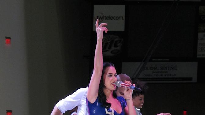 "Pop singer Katy Perry, sporting a skin-tight minidress with President Barack Obama's campaign slogan ""Forward"" emblazoned across it, sings at a rally for Obama, Saturday, Nov. 3, 2012, in Milwaukee. (AP Photo/Scott Bauer)"