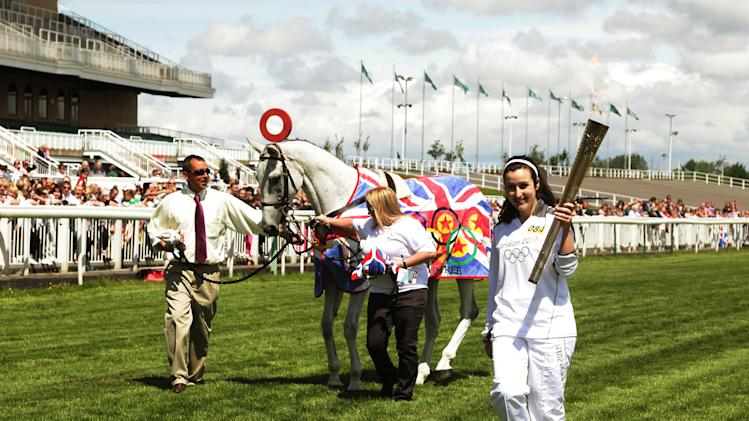 The Olympic Flame Continues Its Journey Around The UK - Day 14