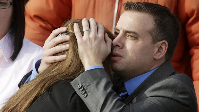 Mourners embrace following funeral services for Connecticut elementary shooting victim Emilie Parker, Saturday, Dec. 22, 2012, at The Church of Jesus Christ of Latter-day Saints, in Ogden, Utah. (AP Photo/Rick Bowmer)