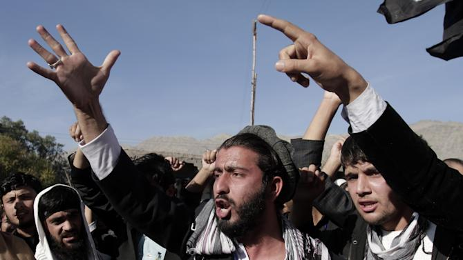 Afghan students of Nangarhar University chant slogans against Israel's recent offensive in Gaza, on the outskirts of Jalalabad, east of Kabul, Afghanistan, Monday, Nov. 26, 2012. (AP Photo/Rahmat Gul)