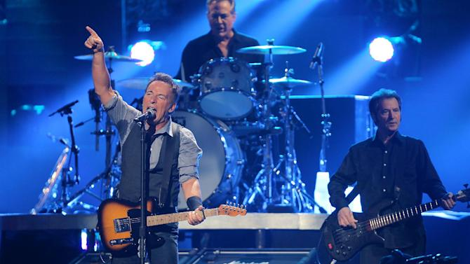 In this image released by Starpix, Bruce Springsteen and the E street Band perform at 12-12-12 The Concert for Sandy Relief at Madison Square Garden in New York on Wednesday, Dec. 12, 2012. (AP Photo/Starpix, Dave Allocca)