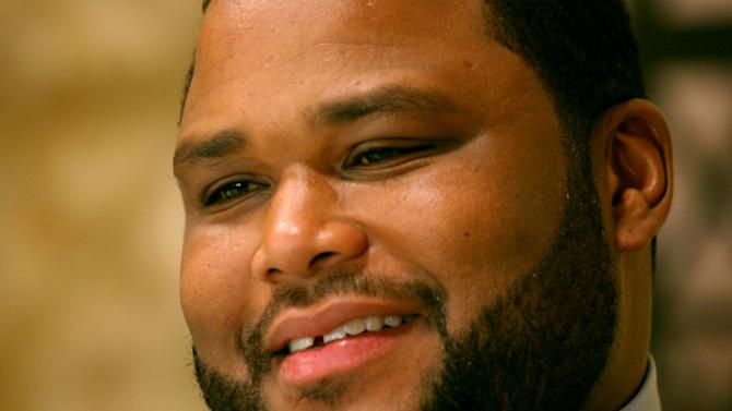 """File-This photo taken  April 17, 2008 shows actor Anthony Anderson speaking during an interview on the set of """"Law and Order"""" in New York. Anderson remembers when he worried about scrounging up money to pay for the rest of his college tuition, food and housing while attending Howard University. Now the """"Black-ish"""" star wants to help students avoid the same struggle. The actor-comedian and other celebrities through their foundations teamed up with the United Negro College Fund to donate scholarships to worthy students who are farthing their education. (AP Photo/Bernadette Tuazon,File)"""