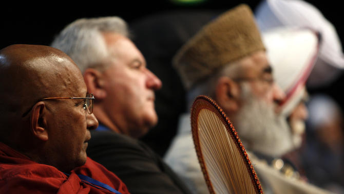 Representatives from various religions are seated on the stage during an Islamic peace conferencen in London, Saturday, Sept. 24, 2011.   The conference attended by thousands of British and European Muslims is aimed at tackling extremists and promoting peace, tolerance and community cohesion in wake of recent riots and 9/11 anniversary. (AP Photo/Akira Suemori)
