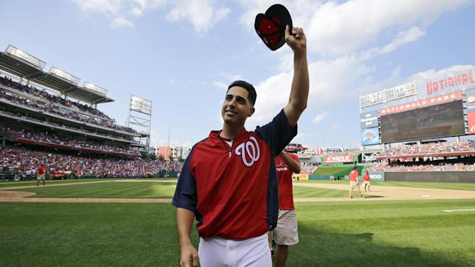 Washington Nationals starting pitcher Gio Gonzalez acknowledges the crowd after a baseball game against the Milwaukee Brewers at Nationals Park Saturday, Sept. 22, 2012, in Washington. It was Gonzalez's 20th win of the season, and the Nationals won 10-4. (AP Photo/Alex Brandon)