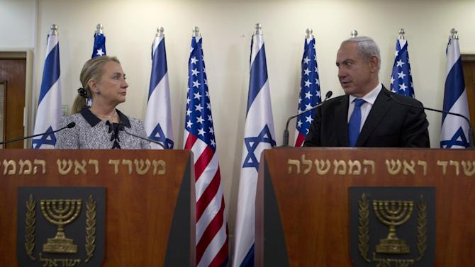 """Israel's Prime Minister Benjamin Netanyahu and U.S. Secretary of State Hillary Rodham Clinton deliver joint statements in Jerusalem, Tuesday, Nov. 20, 2012. A diplomatic push to end Israel's nearly weeklong offensive in the Gaza Strip gained momentum Tuesday, with Egypt's president predicting that airstrikes would soon end, the U.S. secretary of state racing to the region and Israel's prime minister saying his country would be a """"willing partner"""" to a cease-fire with the Islamic militant group Hamas.(AP Photo/Baz Ratner, Pool)"""