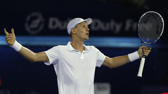 Tomas Berdych of the Czech Republic reacts after a line call during his match against Roger Federer of Switzerland in the semi-finals of the Dubai Duty Free Tennis Championships in Dubai, United Arab Emirates, Monday, March 1, 2013. (AP Photo/Regi Varghese)