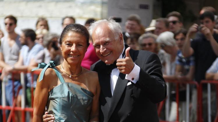 German politician Huber and his wife Helma arrive on the red carpet for the opening of the Bayreuth Wagner opera festival outside the Gruener Huegel (Green Hill) opera house in Bayreuth