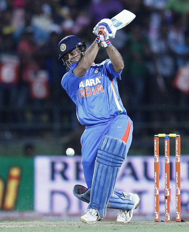 India's captain Dhoni plays a shot during the Twenty20 match against Sri Lanka in Pallekele