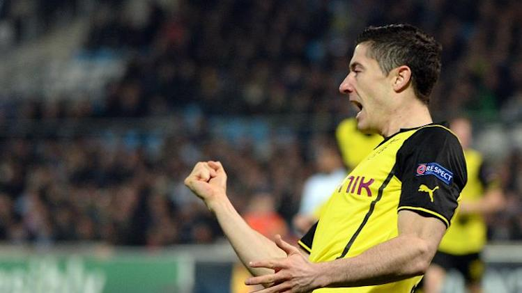 Dortmund's Polish striker Robert Lewandowski celebrates after scoring a goal on December 11, 2013 at the Velodrome stadium in Marseille, southern France