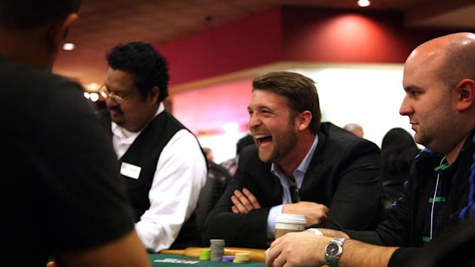 In this photo taken Saturday, Jan. 19, 2013, Mark Peters of Santa Clara University plays poker during the MBA Poker Championship and Recruitment Weekend at Planet Hollywood in Las Vegas. (AP Photo/Las Vegas Sun, Leila Navidi)