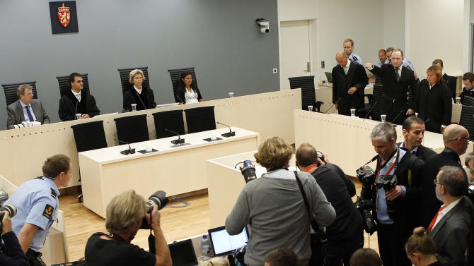 """Confessed mass killer Anders Behring Breivik, top third right, salutes as he arrives in the Oslo court room Friday Aug. 24, 2012 to receive his judgment. Anders Behring Breivik has been declared sane and sentenced to prison for bomb and gun attacks that killed 77 people last year. Reading the ruling, Judge Wenche Elisabeth Arntzen handed down a sentence of """"preventive detention"""" of at least 10 years and a maximum of 21 years. However, such sentences can be extended under Norwegian law as long as an inmate is considered dangerous. (AP Photo/Cornelius Poppe / NTB scanpix, Pool)"""