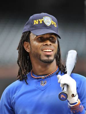 New York Mets shortstop Jose Reyes wears a New York Police Department cap during batting practice before the  Mets baseball game against the Chicago Cubs at Citi Field in New York, Sunday, Sept. 11, 2011. (AP Photo/Kathy Kmonicek)