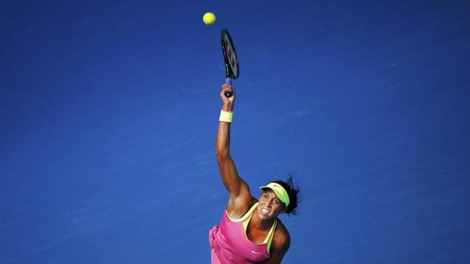 Keys of the U.S. serves to compatriot Venus during their women's singles quarter-final match at the Australian Open 2015 tennis tournament in Melbourne
