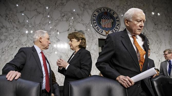 Sen. Jeff Sessions, R-Ala., left, talks with Sen. Dianne Feinstein, D-Calif., on Capitol Hill in Washington, Thursday, Jan. 29, 2015, before the start of the Senate Judiciary Committee's confirmation hearing of President Barack Obama's nomination of Loretta Lynch to be attorney general. Sen. Orrin Hatch, R-Utah is at right. Lynch did not appear at the second and final day of her confirmation hearing, which was designed instead to feature testimony from outside experts, several summoned by Republicans to amplify their criticism of Obama and his current attorney general, Eric Holder. (AP Photo/J. Scott Applewhite)