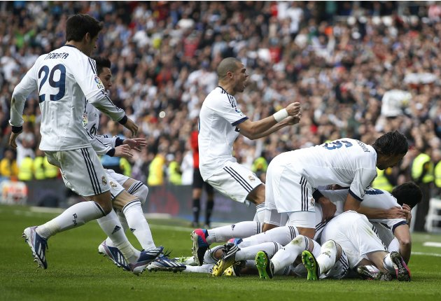 "Real Madrid players celebrate after Ramos scored the team's second goal to put them in the lead during their Spanish first division ""classico"" match against Barcelona in Madrid"