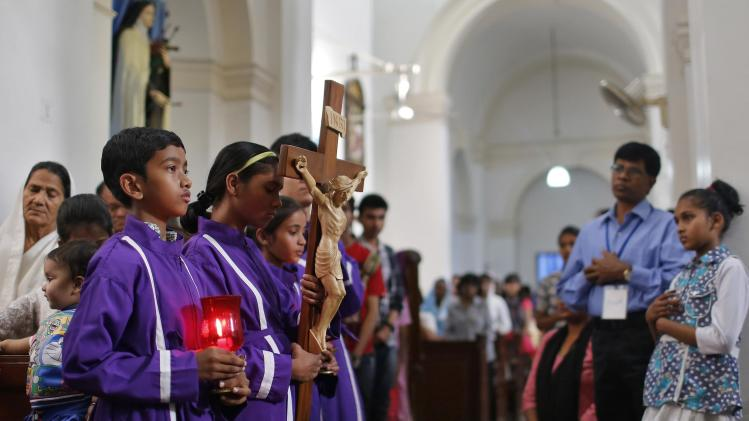 Catholic devotees attend a Good Friday Mass inside at a church in New Delhi