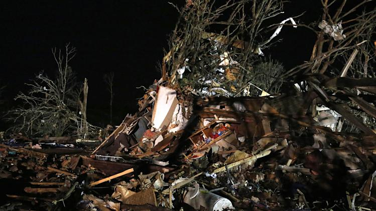 Debris is scattered in what was a mobile home park where a tornado struck near Dale, Okla., Sunday, May 19, 2013. (AP Photo Sue Ogrocki)