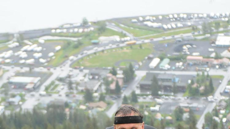 "In this photo taken July 4, 2012 and provided by TSS Photography, 65-year-old Michael LeMaitre competes in the Mount Marathon race in Seward, Alaska. Peggy LeMaitre is no longer holding out hope that her husband is still alive five weeks and multiple searches after he vanished without a trace while running in the popular extreme race. The Anchorage woman says the only hope she has left is that searchers will find his body so that the family and ""can put him to rest.""  (AP Photo/TSS Photography, Davis Stewart)"