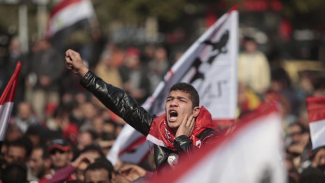 An Egyptian soccer fan shouts anti-ruling military council slogans during a protest at Sphinx square in Cairo, Egypt, against killing of at least 74 people in the country's worst ever soccer violence, Thursday, Feb. 2, 2012. Scores of Egyptian soccer fans were crushed to death Wednesday, Feb. 1, 2012, while others were fatally stabbed or suffocated after being trapped in a long narrow corridor trying to flee rival fans armed with knives, clubs and stones, in the country's worst ever soccer violence that killed at least 74 people, witnesses and health officials said Thursday. The white flags are for the Zamalek soccer club. (AP Photo/Amr Nabil)