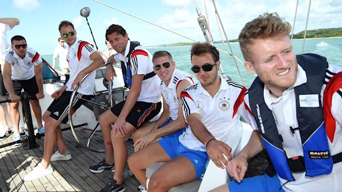 German national soccer players Lukas Podolski, from left, Benedikt Hoewedes, Roman Weidenfeller, Bastian Schweinsteiger, Mario Goetze and Andre Schuerrle sit on a boat in Santo Andre near Porto Seguro, Brazil, Tuesday, June 10, 2014. The German team got some motivation help from explorer and adventurer Mike Horn during a sailing outing near their camp on Brazil's Atlantic coast
