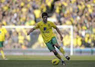 South African-born Norwich midfielder Andrew Surman, pictured in action in February 2012, is not interested in playing for his native country's Bafana Bafana (The Boys) in next year's Africa Cup of Nations, the national coach said.