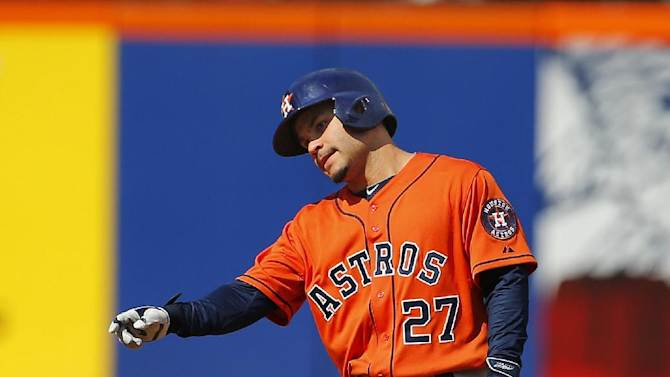 Houston Astros' Jose Altuve (27) reacts at second base after he hit a double against the New York Mets during the third inning of an inter-league baseball game Sunday, Sept. 28, 2014 at Citi Field in New York. The mets defeated the Astros 8-3. (AP Photo/Rich Schultz)