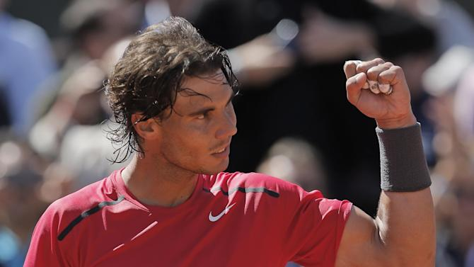 Rafael Nadal of Spain celebrates winning his semi final match against compatriot David Ferrer at the French Open tennis tournament in Roland Garros stadium in Paris, Friday June 8, 2012. Nadal won in three sets 6-2, 6-2, 6-1. (AP Photo/Bernat Armangue)