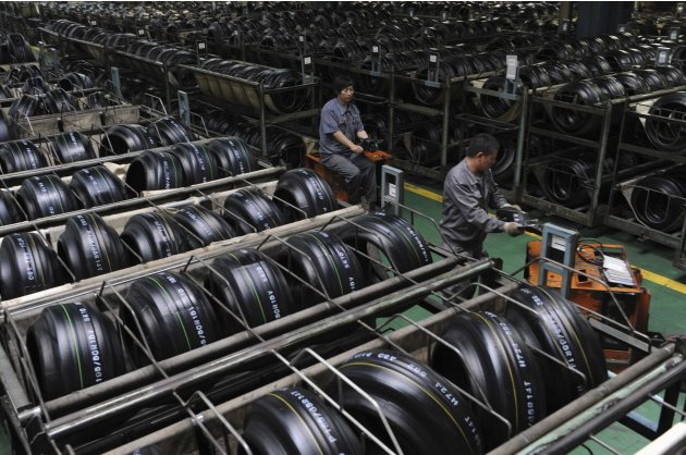 File photo of employees transporting tyres at a Hankook Tire factory in Jiaxing