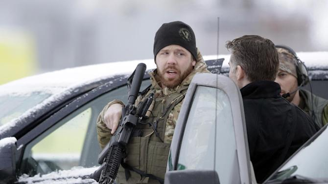 Members of the FBI stand guard at the Burns Municipal Airport, Sunday, Jan. 10, 2016, in Burns, Ore. A small, armed group has been occupying a remote national wildlife refuge in Oregon since a week earlier to protest federal land use policies. (AP Photo/Rick Bowmer)