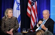 "US Secretary of State Hillary Clinton and Israeli President Shimon Peres participate in a discussion June 12, in Washington, DC. President Barack Obama praised Peres as the ""essence of Israel itself"" as he awarded the Israeli statesman America's highest civilian honor"