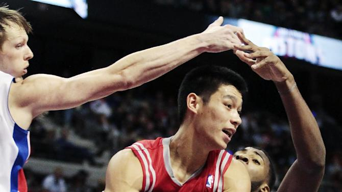 Houston Rockets guard Jeremy Lin is forced to pass the ball against the defensive play of Detroit Pistons forward Kyle Singler, left, and forward Andre Drummond, right, in the first half of an NBA basketball game, Wednesday, Oct. 31, 2012, in Detroit. (AP Photo/Duane Burleson)