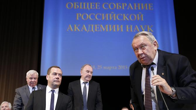 "Russian Prime Minister Dmitry Medvedev, foreground left , and President of the Russian Academy of Sciences Vladimir Fortov, right, attend a general meeting of the Russian Academy of Sciences in Moscow, Russia, Tuesday, March 24, 2015. The sign in the back reads ""A general meeting of the Russian Academy of Sciences."" (AP Photo/RIA-Novosti, Dmitry Astakhov, Government Press Service)"