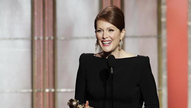 """This image released by NBC shows actress Julianne Moore, winner of the award for best actress in a mini-series or TV movie for her role in """"Game Change,"""" on stage during the 70th Annual Golden Globe Awards at the Beverly Hilton Hotel on Jan. 13, 2013, in Beverly Hills, Calif. (AP Photo/NBC, Paul Drinkwater)"""