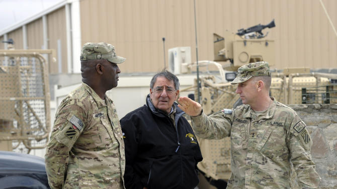 U.S. Defense Secretary Leon Panetta, center, talks with Army Maj. Gen. Robert Abrams, right, and Command Sgt. Maj. Edd Watson, left, during a visit to Kandahar Airfield in Kandahar, Afghanistan, Thursday, Dec. 13, 2012. (AP Photo/Susan Walsh, Pool)