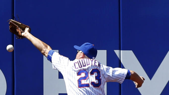 New York Mets left fielder Michael Cuddyer (23) misses Washington Nationals' Danny Espinosa's sixth-inning double in a baseball game in New York, Sunday, May 3, 2015. (AP Photo/Kathy Willens)