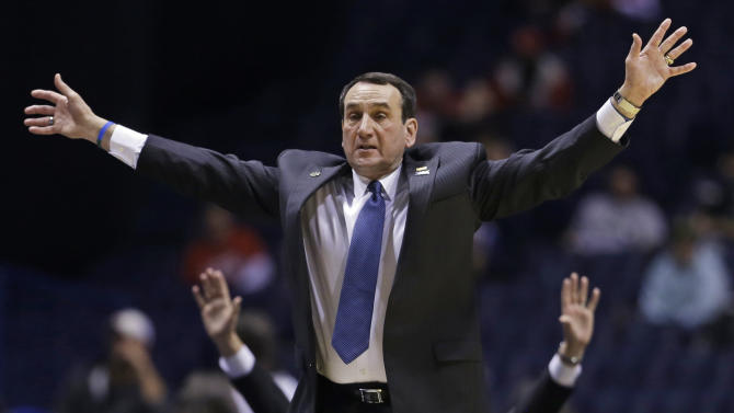 Duke head coach Mike Krzyzewski directs his team during the second half of a regional semifinal against Michigan State in the NCAA college basketball tournament, Friday, March 29, 2013, in Indianapolis. (AP Photo/Darron Cummings)