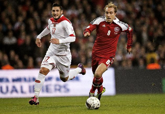 Malta's Ryan Fenech, left, and Denmark's Christian Eriksen, right, vie for the ball during their  Group B 2014 FIFA World Cup qualifying soccer match played in Parken, Copenhagen on Tuesday, Oct 15, 2