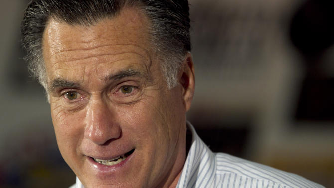 Republican presidential candidate, former Massachusetts Gov. Mitt Romney speak during a campaign stop at a restaurant in Springfield, Ill., Monday, March 19, 2012. (AP Photo/Steven Senne)