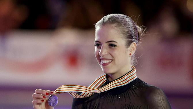 Carolina Kostner, of Italy, displays the silver medal following the ladies competition at the World Figure Skating Championships, Saturday, March 16, 2013, in London, Ontario. (AP Photo/Darron Cummings)