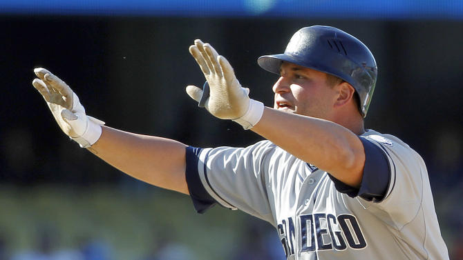 San Diego Padres' Chase Headley reacts at second base after being called out in a ninth-inning triple play by the Los Angeles Dodgers in a baseball game in Los Angeles Sunday, April 15, 2012. The Dodgers won 5-4. (AP Photo/Reed Saxon)