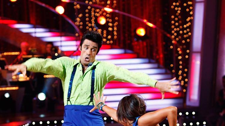 "Gilles Marini and Cheryl Burke perform the Lindy Hop to ""Go Daddy-O"" by Big Bad Voodoo Daddy on ""Dancing with the Stars."""