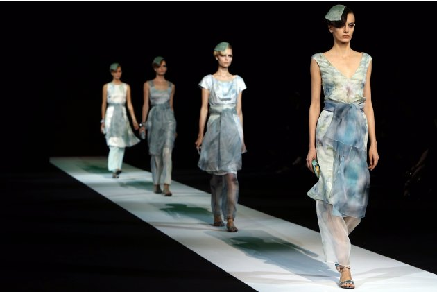 File photo of models displaying creations of Giorgio Armani Spring/Summer 2013 collection at Milan Fashion Week