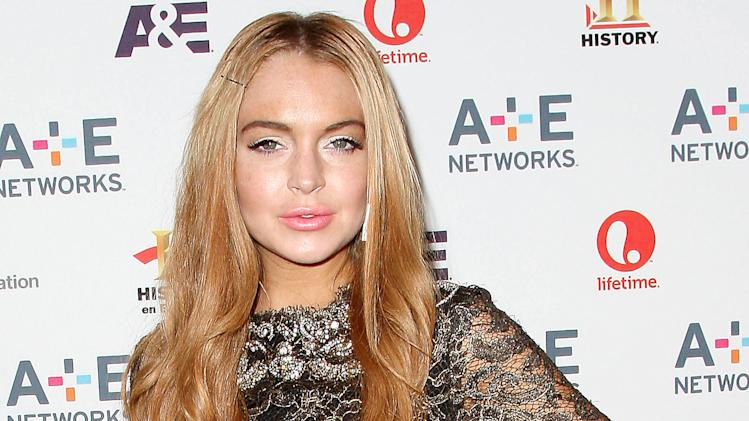 """In this May 9, 2012 photo shows actress Lindsay Lohan at the A&E Networks 2012 Upfront at Lincoln Center in New York. Lohan will star as Elizabeth Taylor in the upcoming Lifetime TV movie """"Liz & Dick."""" Police in Santa Monica, Calif., say Lohan was involved in a car accident on Pacific Coast Highway around 11:45 a.m. Friday and that an investigation is ongoing. (AP Photo/Starpix, Kristina Bumphrey, file)"""