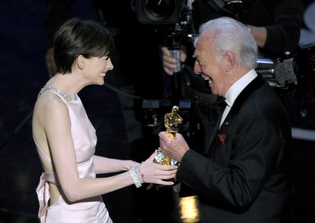 Actor Christopher Plummer, right, presents the award for best actress in a supporting role to Anne Hathaway for &quot;Les Miserables&quot; during the Oscars at the Dolby Theatre on Sunday Feb. 24, 2013, in Los Angeles. (Photo by Chris Pizzello/Invision/AP)