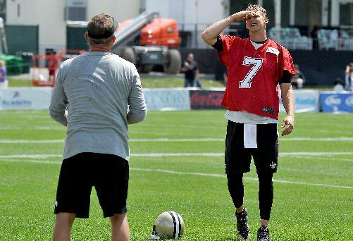 New Orleans Saints quarterback Luke McCown (7) laughs with head coach Sean Payton during NFL football training camp in  White Sulphur Springs, W. Va., Friday, July 25, 2014