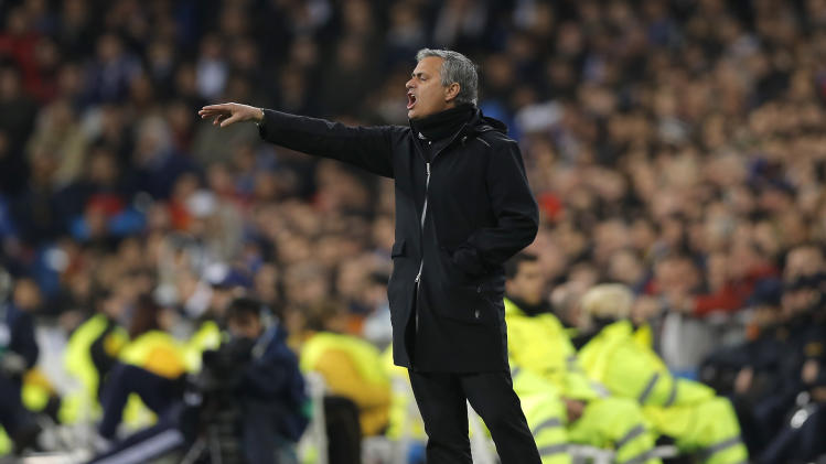Real Madrid's coach Jose Mourinho from Portugal gestures during the Champions League quarterfinals first leg soccer match between Real Madrid and Galatasaray at the Santiago Bernabeu stadium, in Madrid, Wednesday, April 3, 2013. (AP Photo/Daniel Ochoa de Olza)