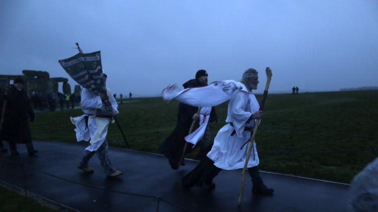 The druid Arthur Pendragon and fellow druids leave the Stonehenge winter solstice celebrations after protesting against the removal of bones by archaeologists from the ancient site in Amesbury, southern England